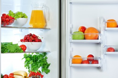 the refrigerator with healthy food fruits and vegetables