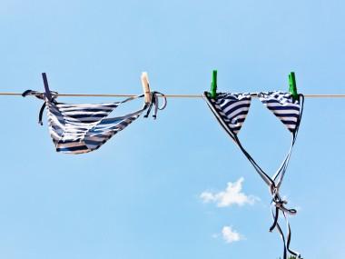 woman swimming bikini suit drying in wind