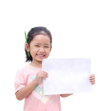 Asian little girl showing blank paper